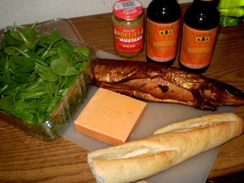 dinner of smoked whitefish, cheddar, arugula, and mustard on baguette with bell's octoberfest