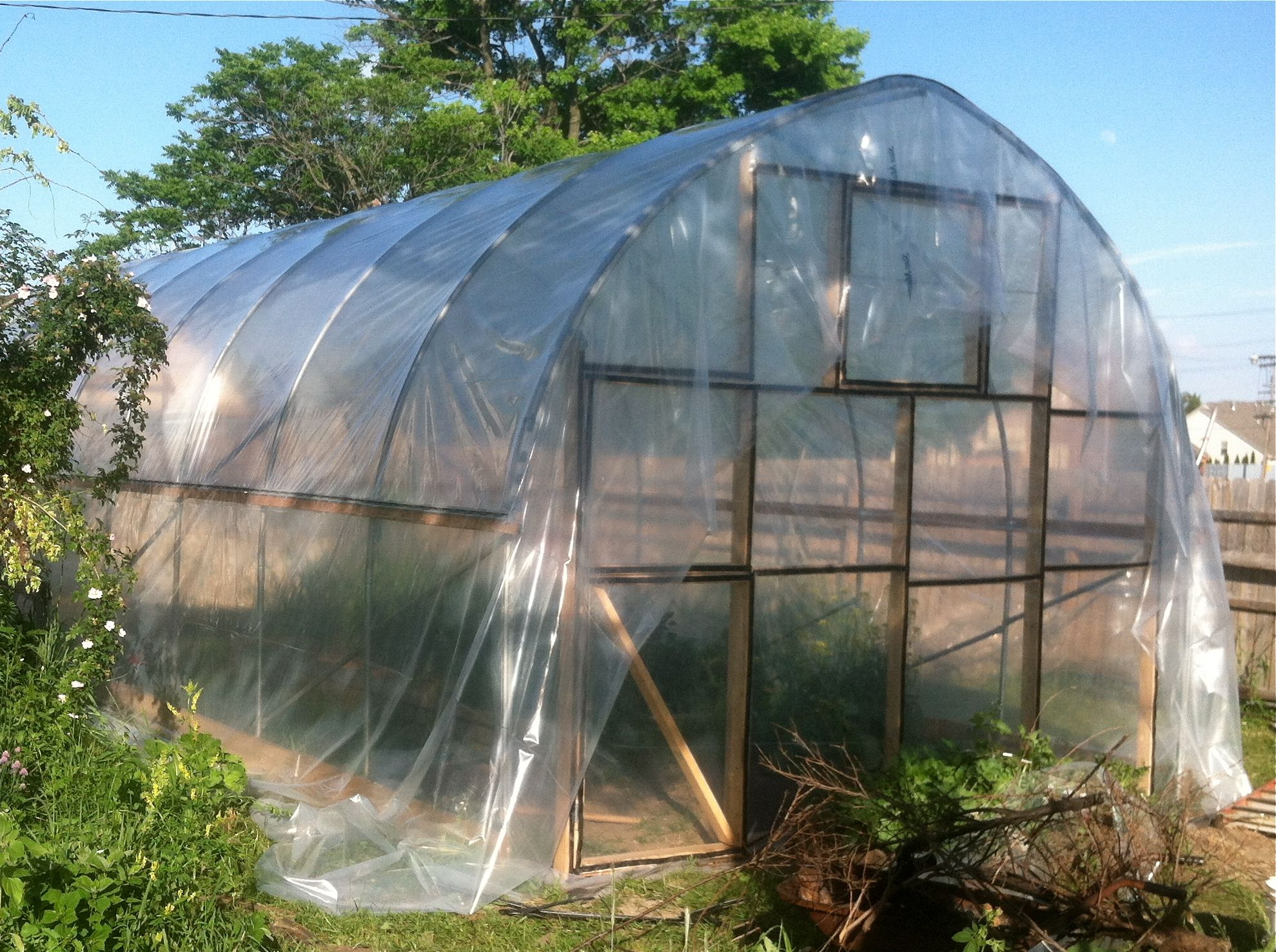 hoop house build part 6: pulling plastic | little house on